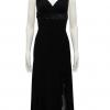 vestido de fiesta negro con falda de picos y lentejuelas