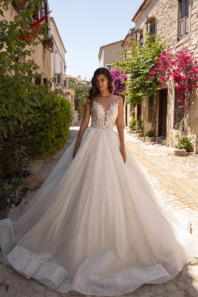 vestido de novia princesa brillante con escote profundo disponible en bogota